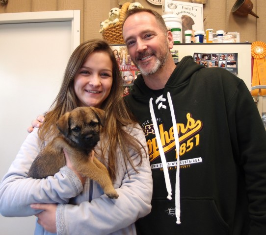 "John and daughter Maddie picking up ""Charlie"""